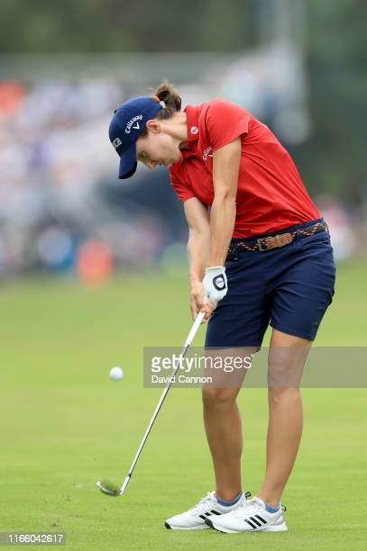 Carlota Ciganda of Spain plays her second shot on the par 4 first hole during the final round of the AIG Women's British Open on the Marquess Course...