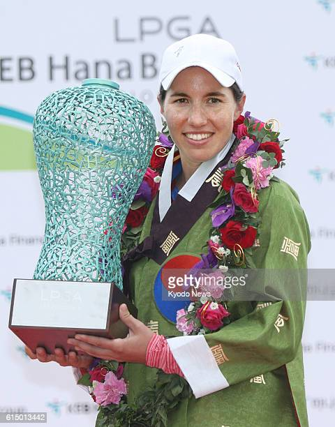 Carlota Ciganda of Spain poses with the winner's trophy after her victory in the LPGA KEB Hana Bank Championship at Sky72 Golf Club in Incheon South...