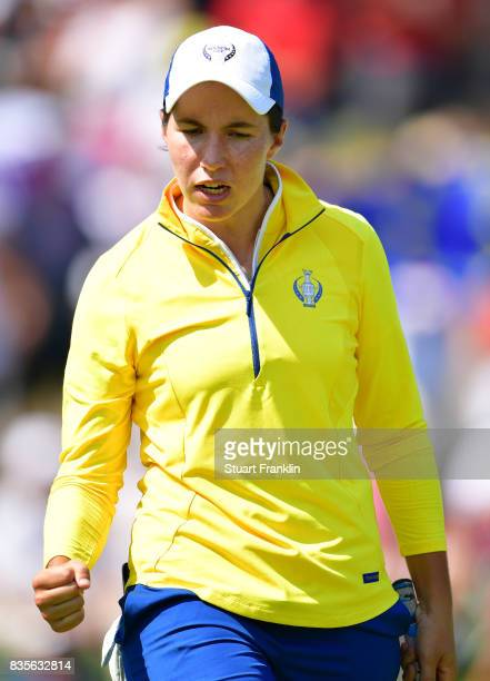 Carlota Ciganda of Team Europe celebrates a putt during the second day afternoon fourball matches of The Solheim Cup at Des Moines Golf and Country...