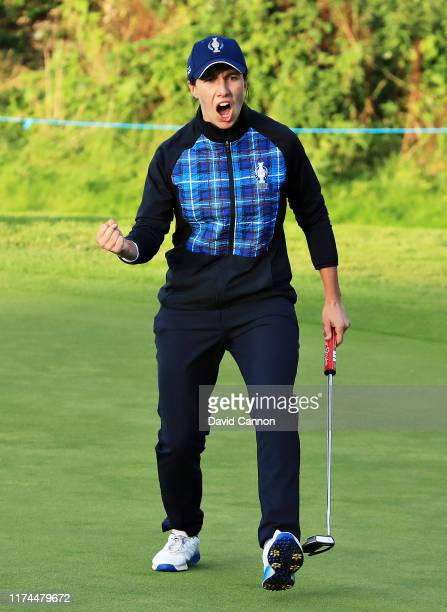 Carlota Ciganda of Team Europe celebrates her putt on the seventeenth green during Day 1 of The Solheim Cup at Gleneagles on September 13 2019 in...