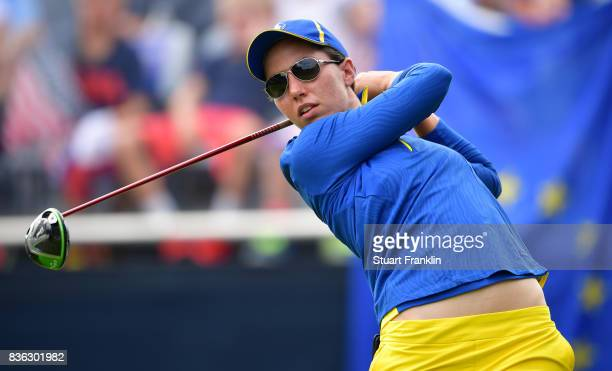 Carlota Ciganda of Team Europe plays a shot during the final day singles matches of The Solheim Cup at Des Moines Golf and Country Club on August 20...