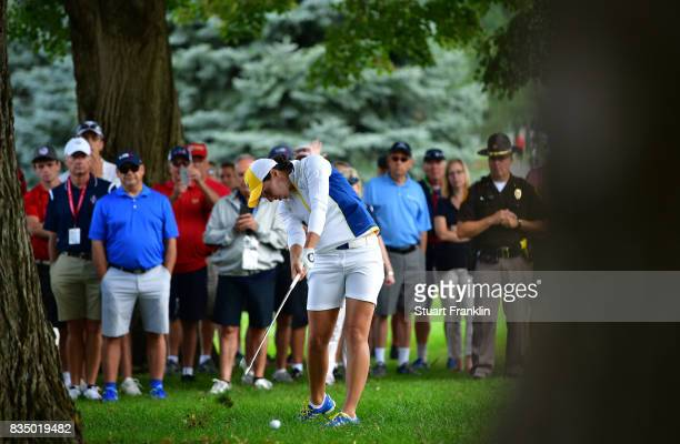 Carlota Ciganda of Team Europe plays a shot during the morning foursomes matches of The Solheim Cup at Des Moines Golf and Country Club on August 18...