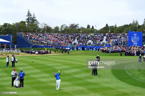 Carlota Ciganda of Team Europe plays her second shot on the first hole in her match against Danielle Kang of Team USA during the final day singles...