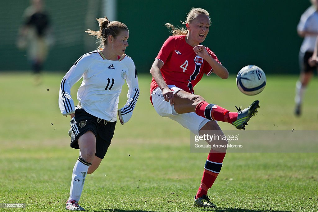 Carlotta Fennefoss of Norway (R) in action against Linda Dallmann of Germany during the Women's U19 Tournament match between U19 Norway and U19 Germany at La Manga Club ground G on March 11, 2013 in La Manga, Spain.