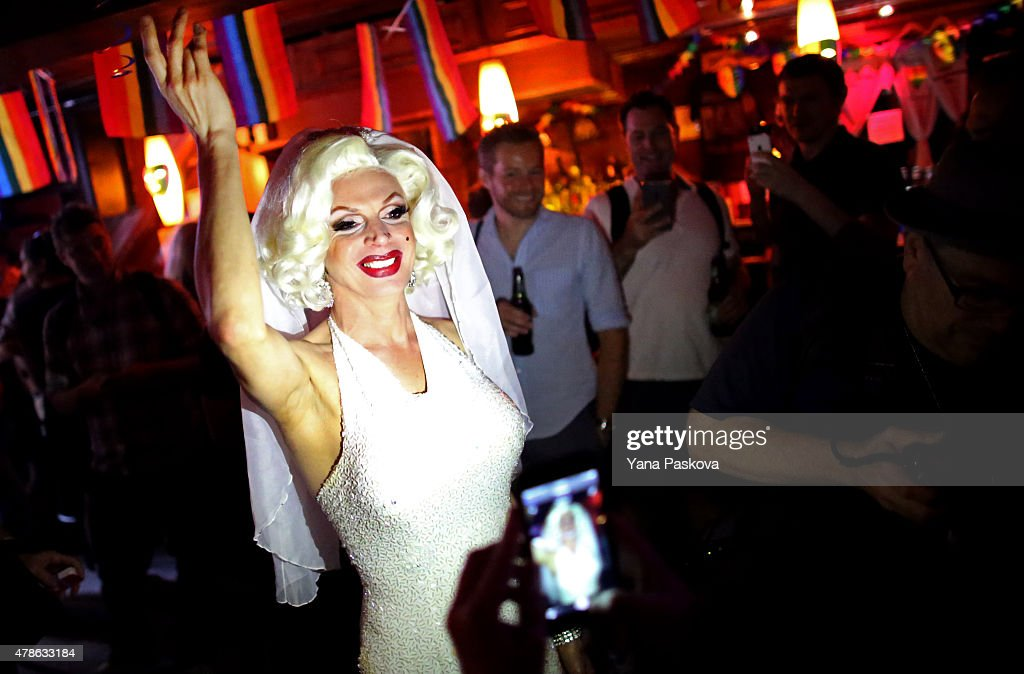 Carlotta Gurl, a gay rights activist from Vancouver, Canada, celebrates inside the Stonewall Inn, an iconic gay bar recently granted historic landmark status, on June 26, 2015 in the West Village neighborhood in New York City. The U.S. Supreme Court ruled that same-sex couples have the right marry in all 50 states.