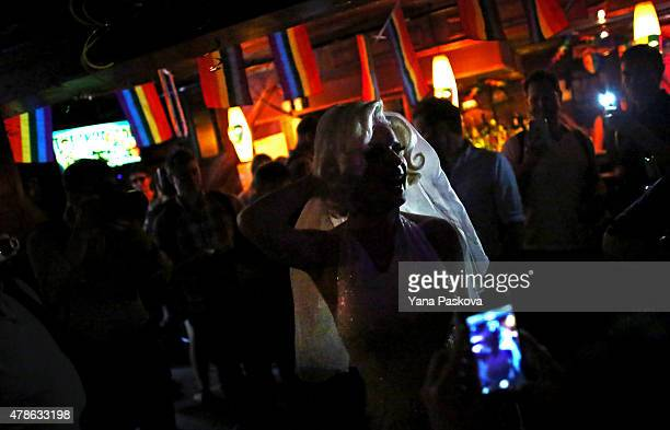 Carlotta Gurl a gay rights activist from Vancouver Canada celebrates inside the Stonewall Inn an iconic gay bar recently granted historic landmark...