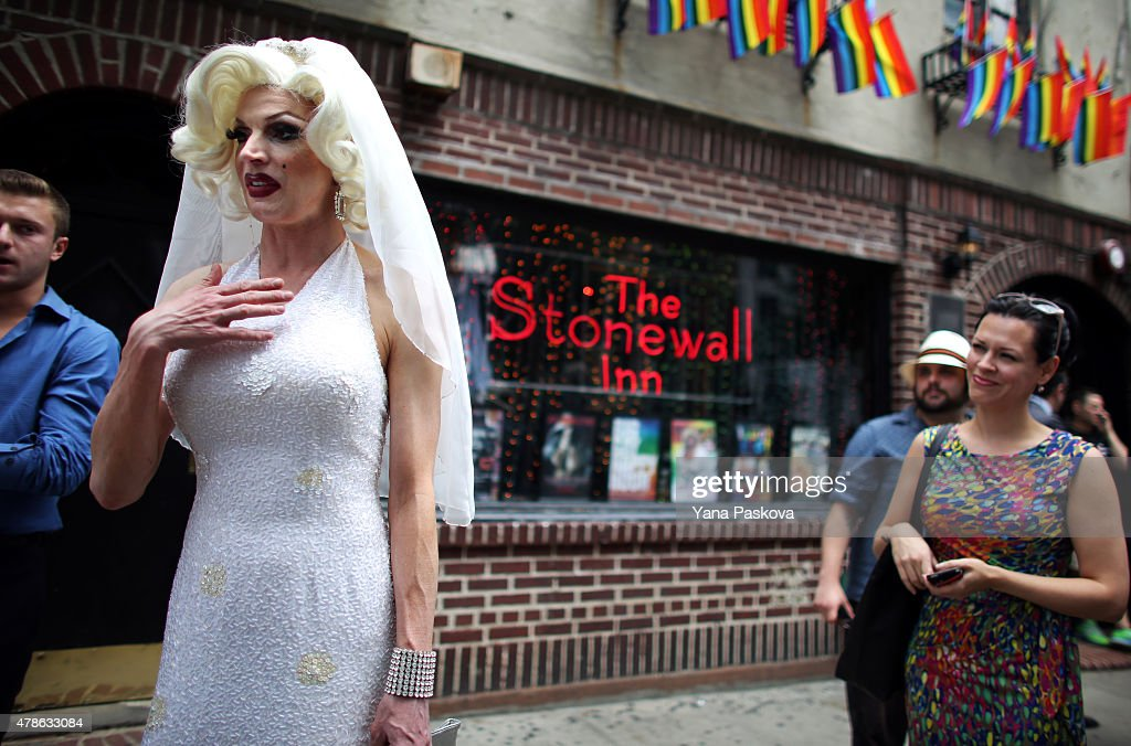 Carlotta Gurl, a gay rights activist from Vancouver, Canada, chats outside of the Stonewall Inn, an iconic gay bar recently granted historic landmark status, on June 26, 2015 in the West Village neighborhood in New York City. The U.S. Supreme Court ruled that same-sex couples have the right marry in all 50 states.