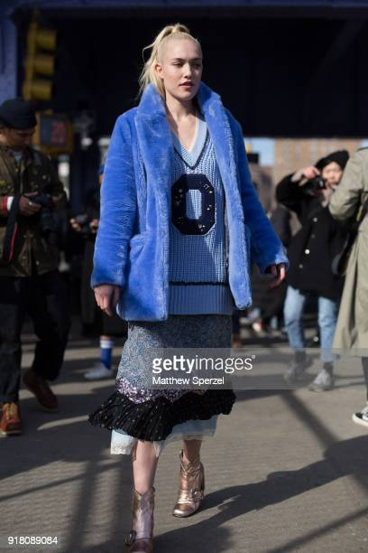 Carlotta Kohl is seen on the street attending Coach 1941 during New York Fashion Week wearing a blue fur coat on February 13 2018 in New York City