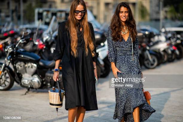 Carlotta Oddi wearing black dress basket bag and Chiara Totire wearing navy dress with dots print is seen outside Alberta Ferretti during Milan...