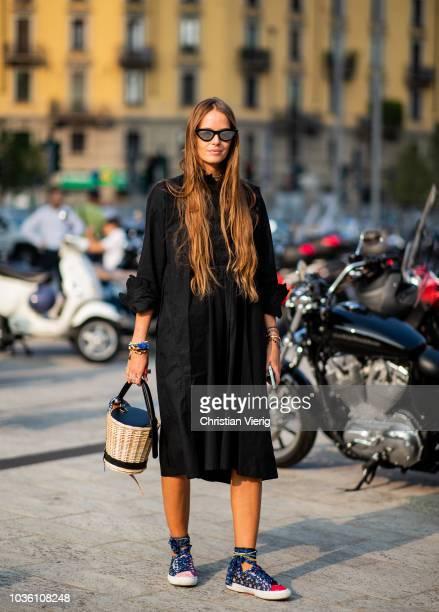 Carlotta Oddi wearing black dress basket bag is seen outside Alberta Ferretti during Milan Fashion Week Spring/Summer 2019 on September 19 2018 in...