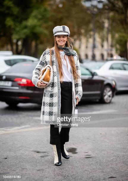 Carlotta Oddi wearing plaid coat, baker boy hat, brown Chanel bag, two tone boots is seen outside Chanel during Paris Fashion Week Womenswear...