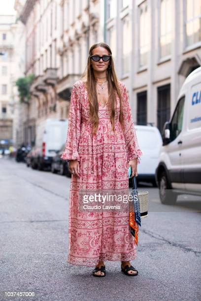 Carlotta Oddi wearing red and white dress and Hermes black sandals is seen before the Blumarine show during Milan Fashion Week Spring/Summer 2019 on...