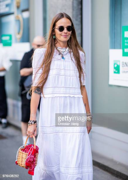 Carlotta Oddi wearing white dress is seen outside Marni during Milan Men's Fashion Week Spring/Summer 2019 on June 16 2018 in Milan Italy