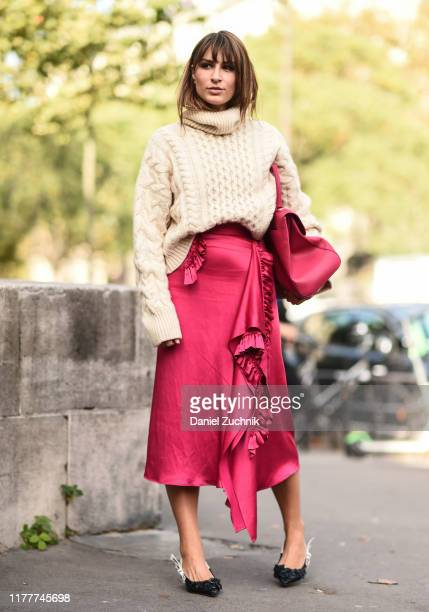 Carlotta Rubaltelli is seen wearing a cream sweater and red silk skirt with a red bag outside the Haider Ackermann show during Paris Fashion Week...