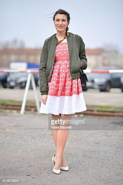 Carlotta Rubaltelli poses wearing a Kiabi bomber jacket and An Italian Theory dress before the Gucci show during the Milan Fashion Week Fall/Winter...
