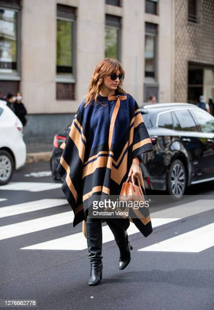 Carlotta Rubaltelli seen wearing Chloe cape, brown bag, black boots outside Boss during the Milan Women's Fashion Week on September 25, 2020 in...