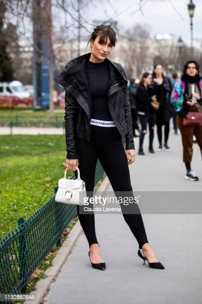 Carlotta Rubaltelli wearing a black top black Paco Rabanne leggings black shoes white bag and black jacket is seen outside Paco Rabanne on Day 4...