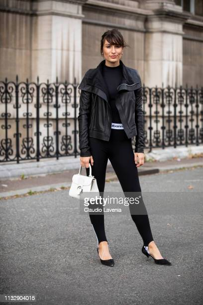 Carlotta Rubaltelli wearing a black top black Paco Rabanne leggings black shoes white bag and black jacket is seen outside Redemption on Day 4 Paris...