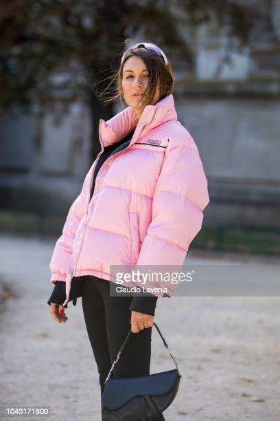 Carlotta Rubaltelli wearing a black top black pants black boots black Dior bag and a pink bomber jacket is seen before the Elie Saab show on...
