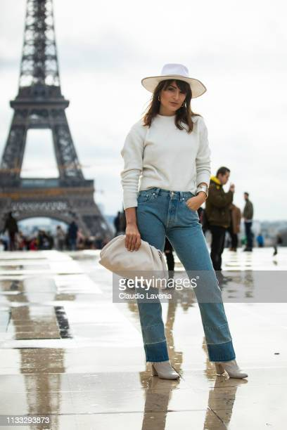 Carlotta Rubaltelli wearing a cream jumper blue jeans cream boots cream bag and cream hat is seen outside Haider Ackermann on Day 6 Paris Fashion...