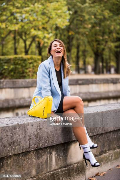 Carlotta Rubaltelli wearing a light blue checked blazer black shorts black sandals with white socks and a yellow Balenciaga bag is seen before the...