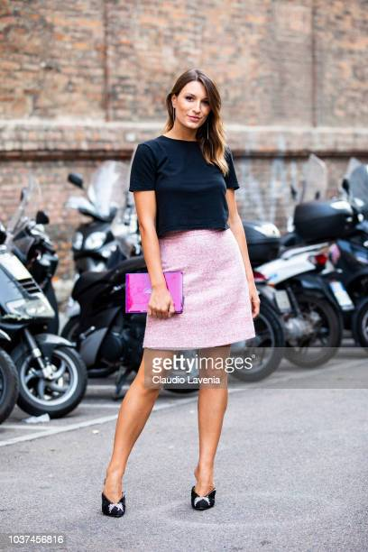 Carlotta Rubaltelli wearing black tshirt and pink skirt is seen before the Blumarine show during Milan Fashion Week Spring/Summer 2019 on September...