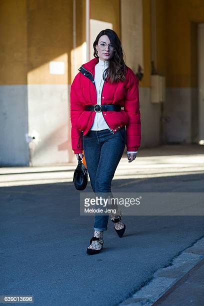 Carlotta Rubaltelli wears an open red puffer jacket from Zara with a belt Levi's jeans an Yves Saint Laurent bag and Proenza Schouler shoes during...
