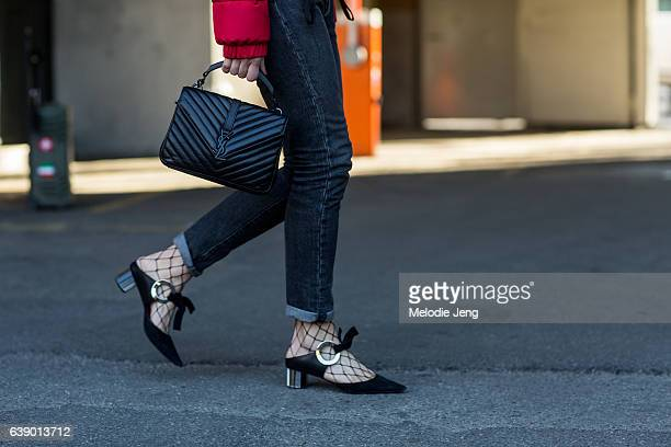 Carlotta Rubaltelli wears Levi's jeans an Yves Saint Laurent bag and Proenza Schouler shoes during Milan Men's Fashion Week Fall/Winter 2017/18 on...