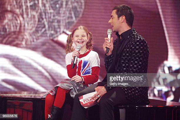 Carlotta Truman and Marco Schreyl perform during the finals of the TV show 'Das Supertalent' on December 19 2009 in Cologne Germany