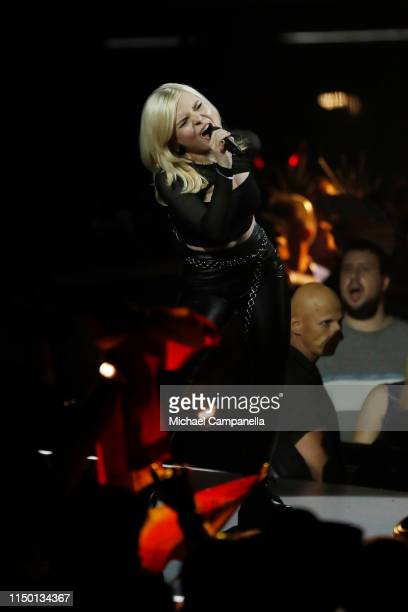 Carlotta Truman of Ssters representing Germany performs live on stage during the 64th annual Eurovision Song Contest held at Tel Aviv Fairgrounds on...