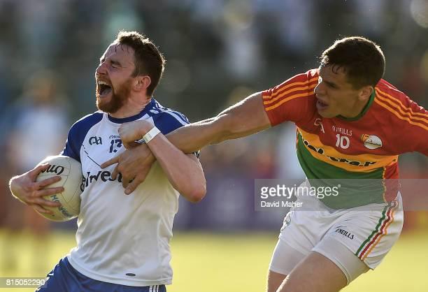 Carlow Ireland 15 July 2017 Owen Duffy of Monaghan in action against Brendan Murphy of Carlow during the GAA Football AllIreland Senior Championship...