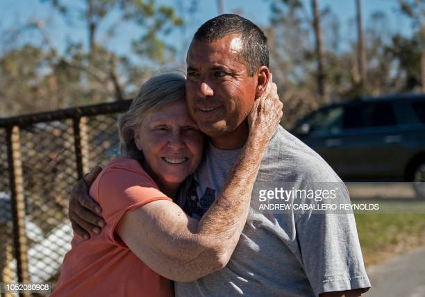 Carloyn Young hugs her relative Robbie Young after finding out he was safe in Port St Joe beach Florida on October 13 three days after hurricane...