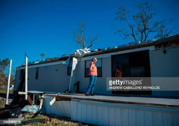 Carloyn Young surveys damage to her property in Port St Joe beach Florida on October 13 three days after hurricane Michael hit the area Since...