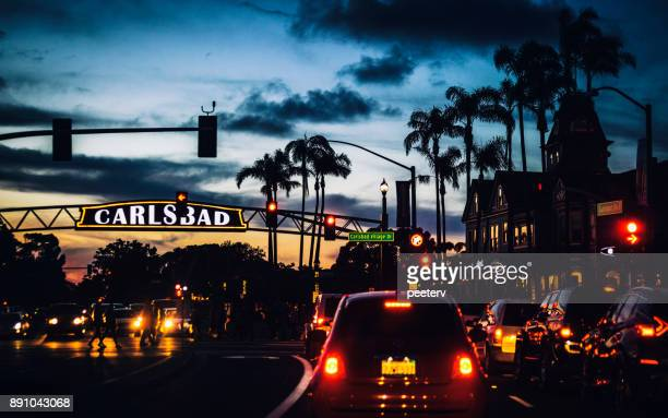carlsbad's welcome sign, sunset traffic in california - carlsbad california stock pictures, royalty-free photos & images
