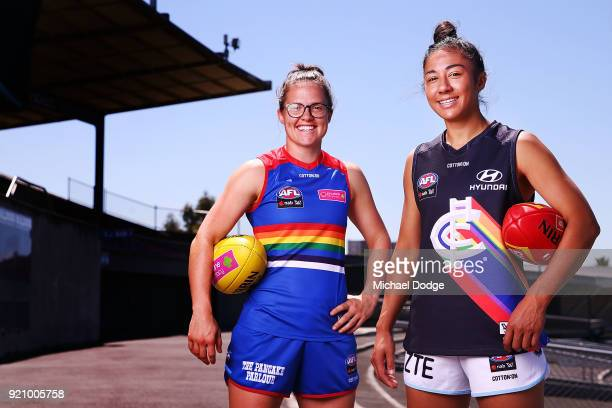 Carlton AFLW forward Darcy Vescio and Bulldog Emma Kearney pose in front of the EJ Whittem Stand with their Pride guernseys for Friday nightÕs game...