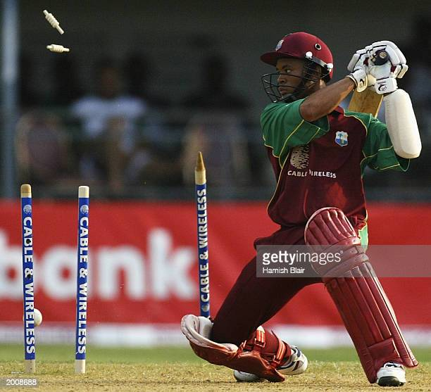 Carlton Baugh of the West Indies is bowled by Glenn McGrath of Australia during the 1st One Day International between the West Indies and Australia...