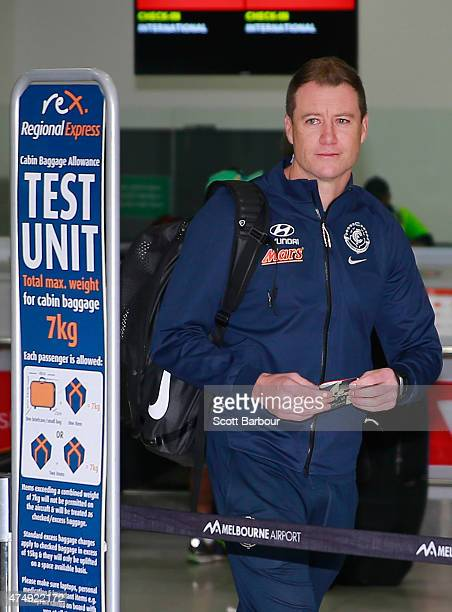 Carlton Blues AFL caretaker coach John Barker checks in for his flight at Melbourne Airport on May 28 2015 in Melbourne Australia