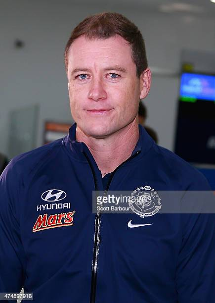 Carlton Blues AFL caretaker coach John Barker looks on as he speaks to the media at Melbourne Airport on May 28 2015 in Melbourne Australia