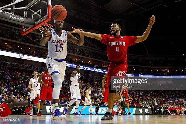 Carlton Bragg Jr. #15 of the Kansas Jayhawks and Josh Robinson of the Austin Peay Governors go for a loose ball during the first round of the 2016...