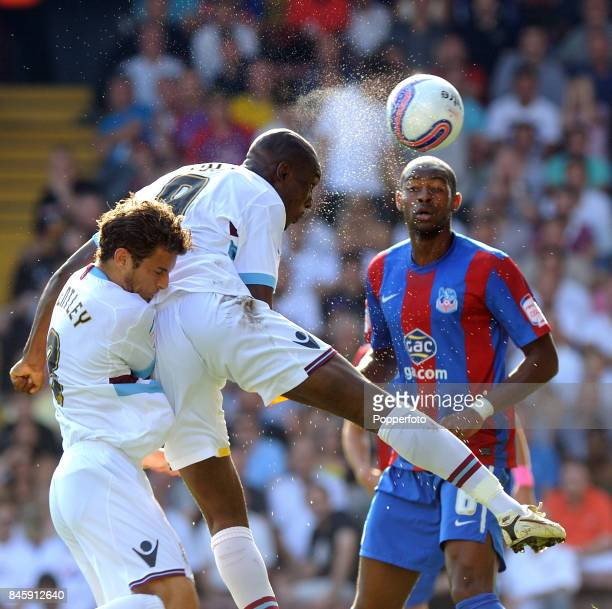 Carlton Cole and David Bentley of West Ham with Anthony Gardner of Crystal Palace in action during the NPower Championship match between Crystal...