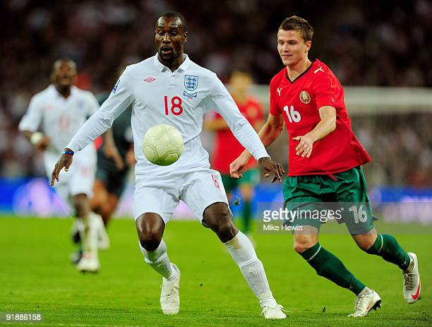Carlton Cole of England and Igor Shitov of Belarus in action during the FIFA 2010 World Cup Qualifying Group 6 match between England and Belarus at...