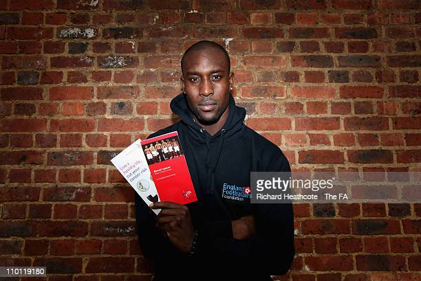 Carlton Cole of England and West Ham United helps launch the Cancer Awareness Roadshow in Hornsey on March 15, 2011 in London, England. The England...