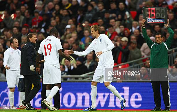 Carlton Cole of England is substituted by Peter Crouch after he was injured during the International Friendly match between England and Slovakia at...