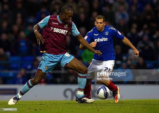 Carlton Cole of West Ham battles for the ball with Tal BenHaim of Portsmouth during the npower Championship match between Portsmouth and West Ham...
