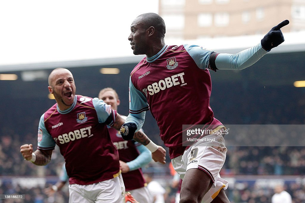 Carlton Cole of West Ham (R) celebrates after scoring the opening goal during the npower Championship match between West Ham United and Millwall, at Boleyn Ground on February 04, 2012 in London, England.