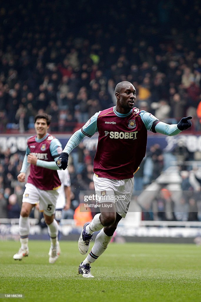Carlton Cole of West Ham celebrates after scoring the opening goal during the npower Championship match between West Ham United and Millwall, at Boleyn Ground on February 04, 2012 in London, England.