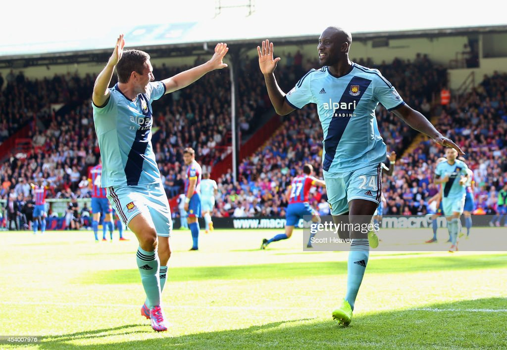 Carlton Cole (R) of West Ham celebrates scoring his team's third goal during the Barclays Premier League match between Crystal Palace and West Ham United at Selhurst Park on August 23, 2014 in London, England.