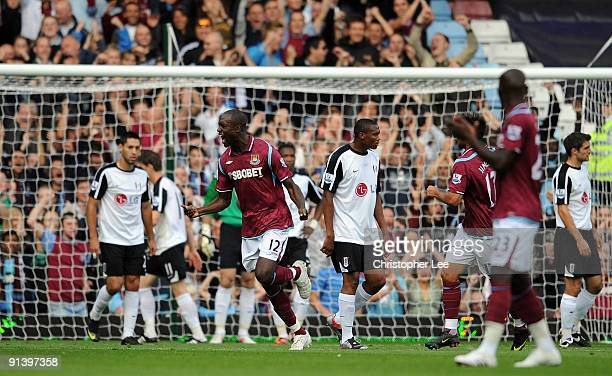 Carlton Cole of West Ham celebrates scoring their first goal during the Barclays Premier League match between West Ham United and Fulham at Upton...