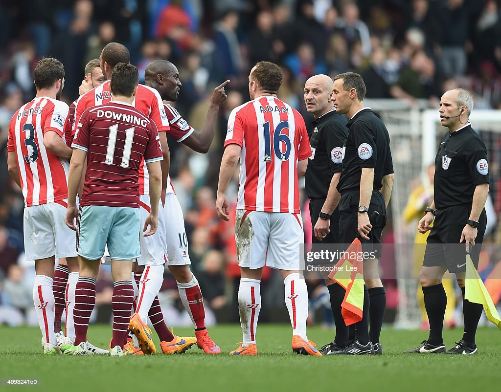 Carlton Cole of West Ham disagrees with the referee during the Barclays Premier League match between West Ham United and Stoke City at Boleyn Ground on April 11, 2015 in London, England.