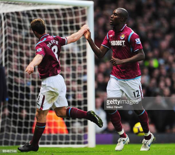 Carlton Cole of West Ham is congratulated by team mate Scott Parker after scoring from the penalty spot during the Barclays Premier League match...